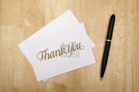 Thank You Note Card and Pen on Wood