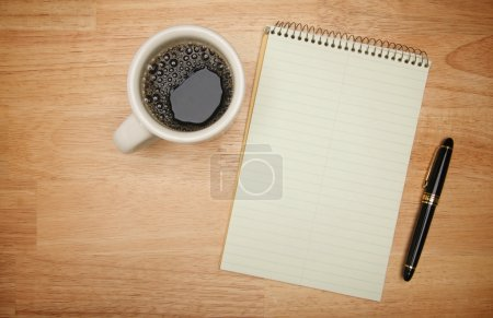 Cup of Coffee, Blank Pad and Pen on Wood