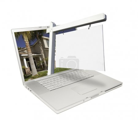 Blank Real Estate Sign and Laptop Isolated on a White Background Ready for Your Own Message.