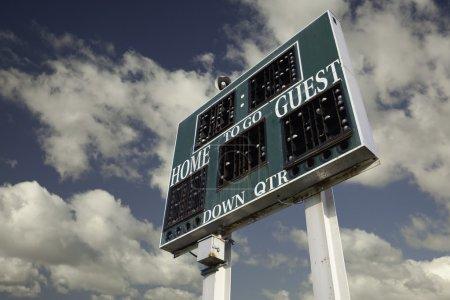 HIgh School Scoreboard Over Sky