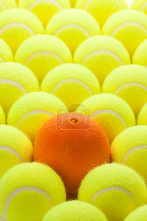 Set of New Tennis Balls and Orange
