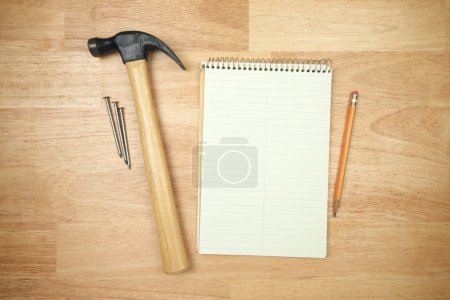 Pad of Paper, Pencil, Hammer and Nails