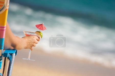 Woman Relaxing on Beach with Drink