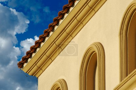 Stucco Wall Arched Windows and Clouds