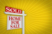 Sold Home for Sale Sign on Yellow Burst