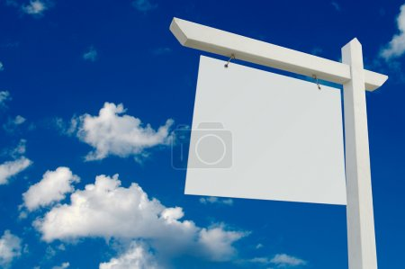 Blank Real Estate Sign OVer Clouds