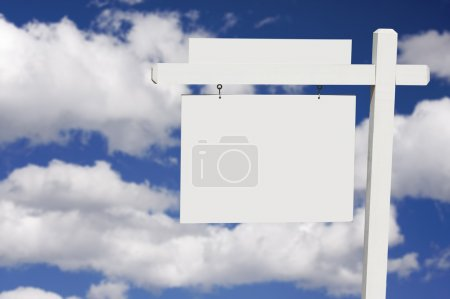 Blank Real Estate Sign on Clouds and Sky