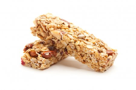 Photo for Two Nutritious Granola Bars Isolated on White with narrow Depth of Field. - Royalty Free Image
