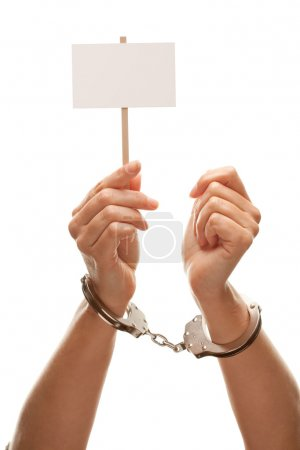 Handcuffed Woman Holds Blank White Sign