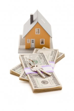 Home and House Keys on Stack of Money Isolated on ...