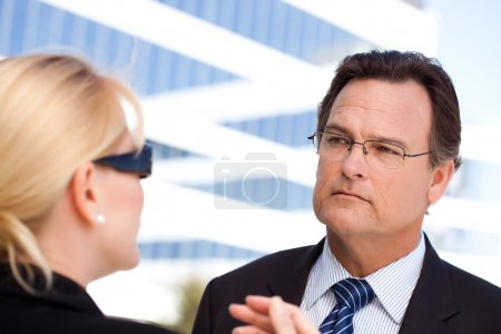 Businessman and Woman Talking Outside