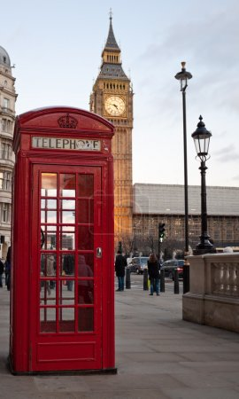 Photo for A traditional red phone booth in London with the Big Ben in the background - Royalty Free Image