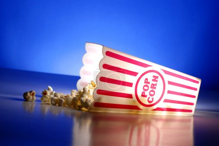 Popcorn for a movie in a popcorn holder and spilli...
