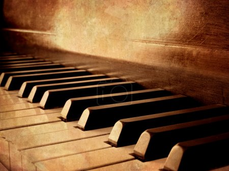 Photo for Closeup of black and white piano keys and wood grain with sepia tone - Royalty Free Image