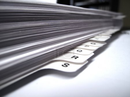 Photo for Office desk with files papers and letter tabs - Royalty Free Image