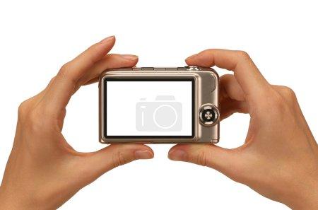 Photo pour Mains féminines prendre photo avec un appareil photo numérique compact - image libre de droit