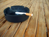 Ashtray with lit cigarette