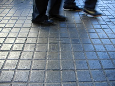 Feet on walkway