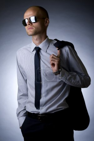 Young businessman looking away