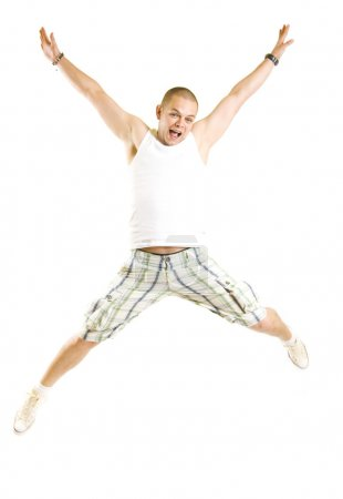 Photo for Casual man jumping of joy over white - Royalty Free Image