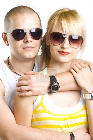 Young casual couple with sunglasses
