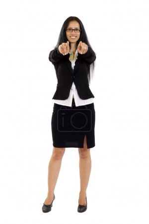 Young smiling business woman pointing