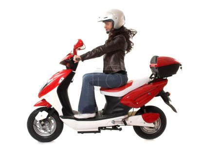 Photo for Woman with helmet riding electric scooter over white background - Royalty Free Image