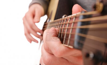 Photo for Close up of guitarist hand playing acoustic guitar - Royalty Free Image