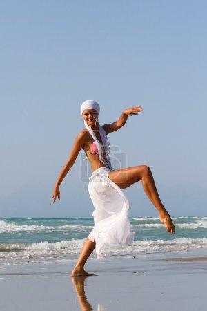 Pretty blonde woman enjoying sea