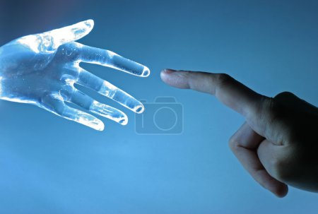 Photo for Human hand touch an atrifical glass hand - Royalty Free Image