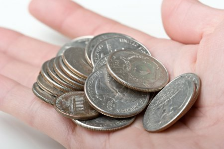 Bunch of 25 cents quarters change coins in a human...