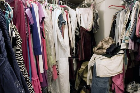 Photo for Messy unorganized closet full of hanging clothes - Royalty Free Image