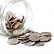 Quarters 25 cents change coins in a glass jar isol...