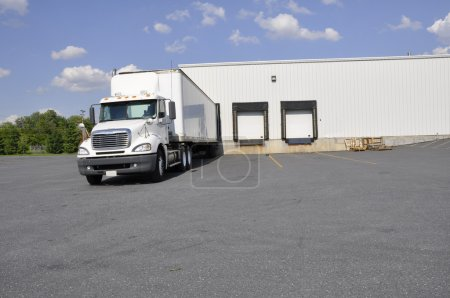Photo for Large truck at a warehouse unloading dock - Royalty Free Image