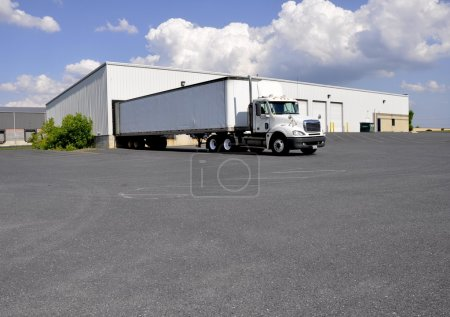 Photo for A large truck at an unloading dock for a warehouse - Royalty Free Image