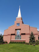 Front of a modern red brick church