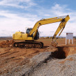 Heavy duty construction equipment by work site...