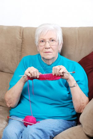 Senior woman counting knitting stitches