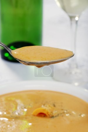 Closeup of spoonful cheddar cheese soup