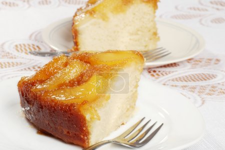Closeup two slices upside down pear cake