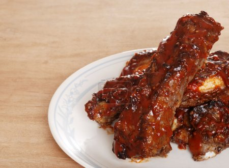 Closeup of barbecue sauce covered beef spare ribs ...
