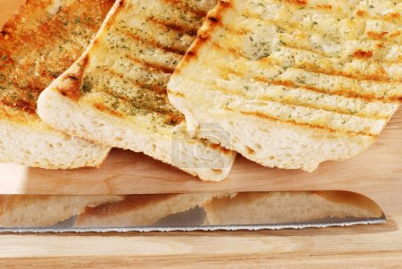 Closeup garlic bread with knife