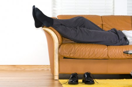 Photo for Business man is relaxing on the couch after a long week - Royalty Free Image