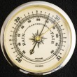 Close-up image of a barometer scale on black textu...