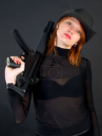 Young woman holding the gun