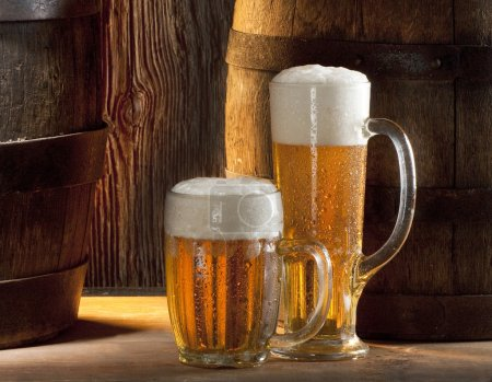 Photo for Two beers with old wood barrels - Royalty Free Image