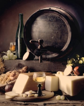 Photo for Still-life with wine and old barrels, cheese and salami - Royalty Free Image