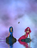 Two Mermaids Sitting On A Rock