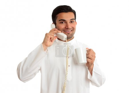 Friendly ethnic businessman on phone