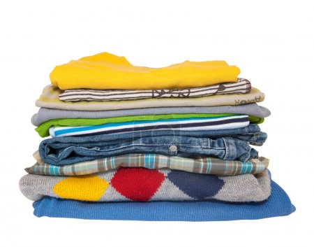 Photo for Pile of colorful vibrant boys clothes isolated on white. - Royalty Free Image